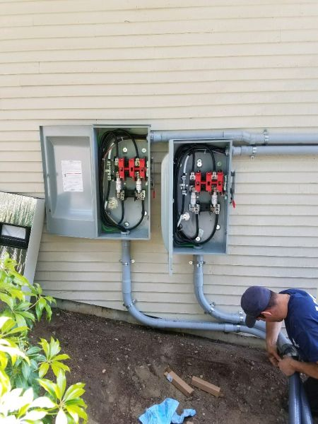Commercial install of dual 200 amp disconnects.